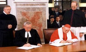 1999 signing of the Joint Doctrine of the Doctrine of Justification (JDDJ) with Bishop Dr. Christian Krause (left) and Edward Idris Cardinal Cassidy (right) (source: elcic.ca)